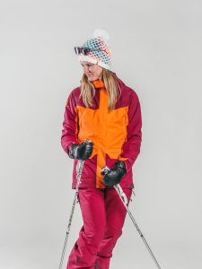 Oxygène Ski & Snowboard School   Female Adult with Ski Poles