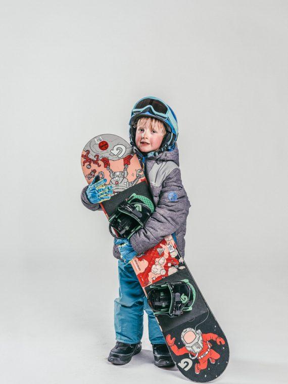 Oxygène Ski & Snowboard School | Child Holding Snowboard 3