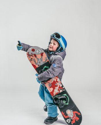 Oxygène Ski & Snowboard School Child Holding Snowboard 2