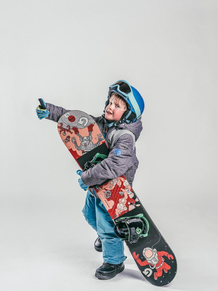 Oxygène Ski & Snowboard School | Child Holding Snowboard 2