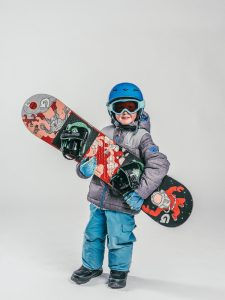 Oxygène Ski & Snowboard School | Child Holding Snowboard