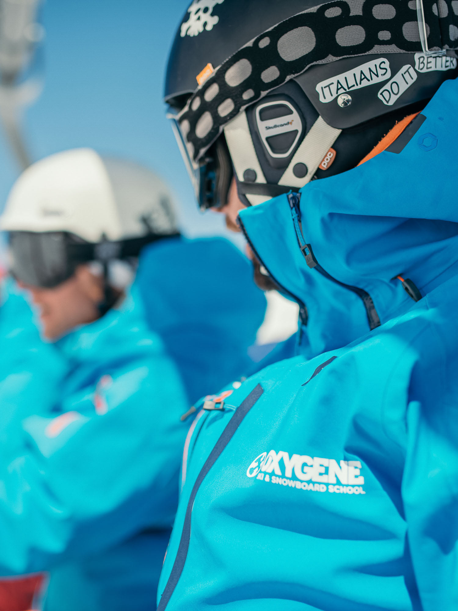 Oxygène Ski & Snowboard School – Instructor in on Chair Lift