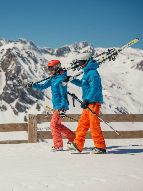 Oxygène Ski & Snowboard School – Instructors Walking with Skis