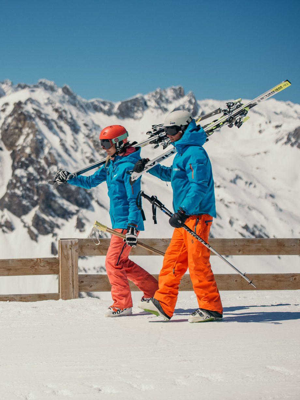 Oxygène Ski & Snowboard School Instructors Walking with Skis