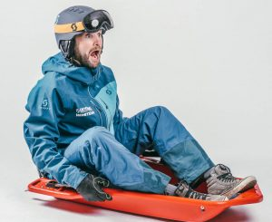 alternative to skiing vs snowboarding is sledging