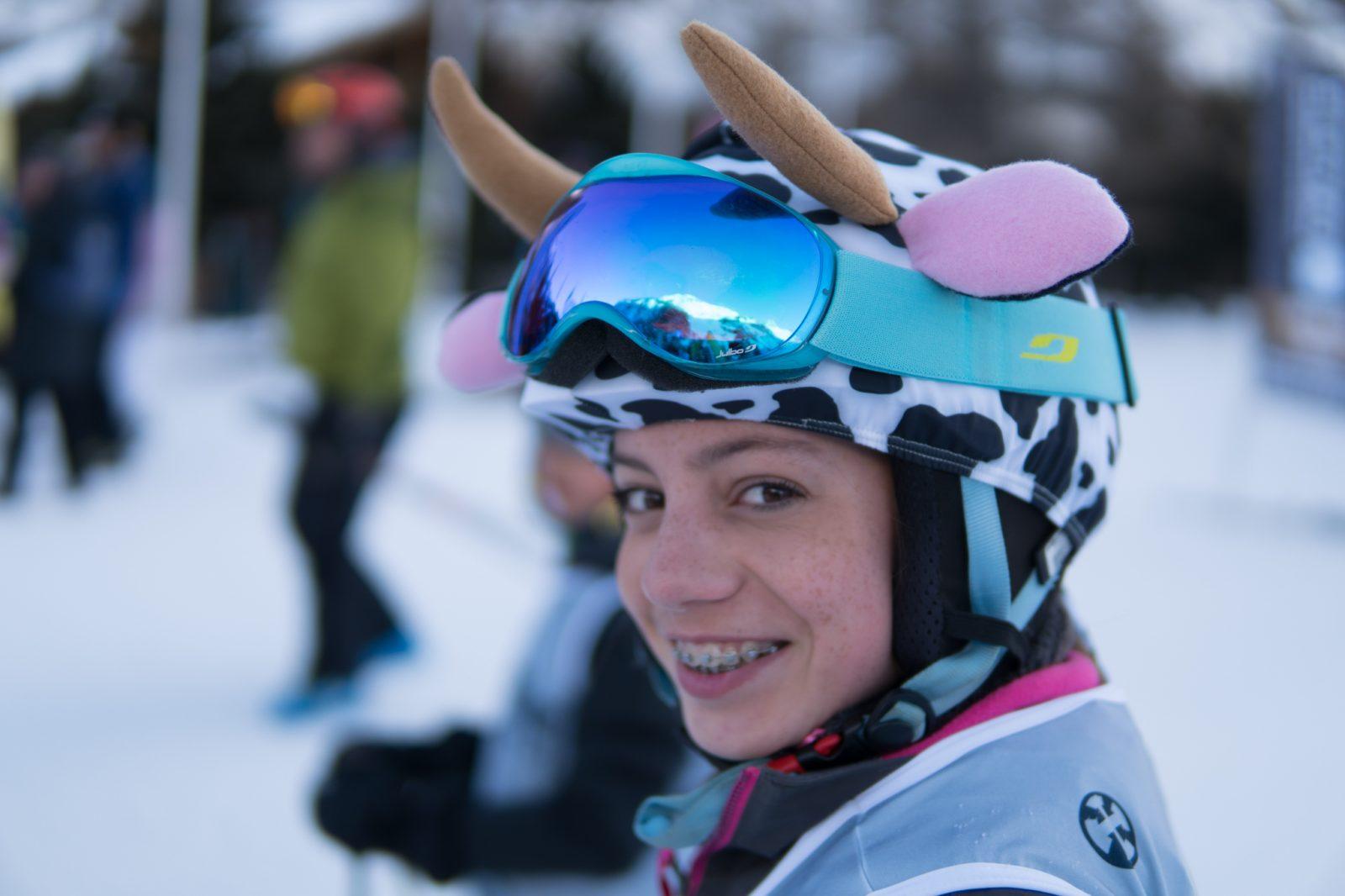 enfant en cours de ski Oxygène avec crazy hat