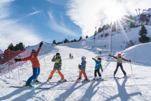 Children and ski instructor