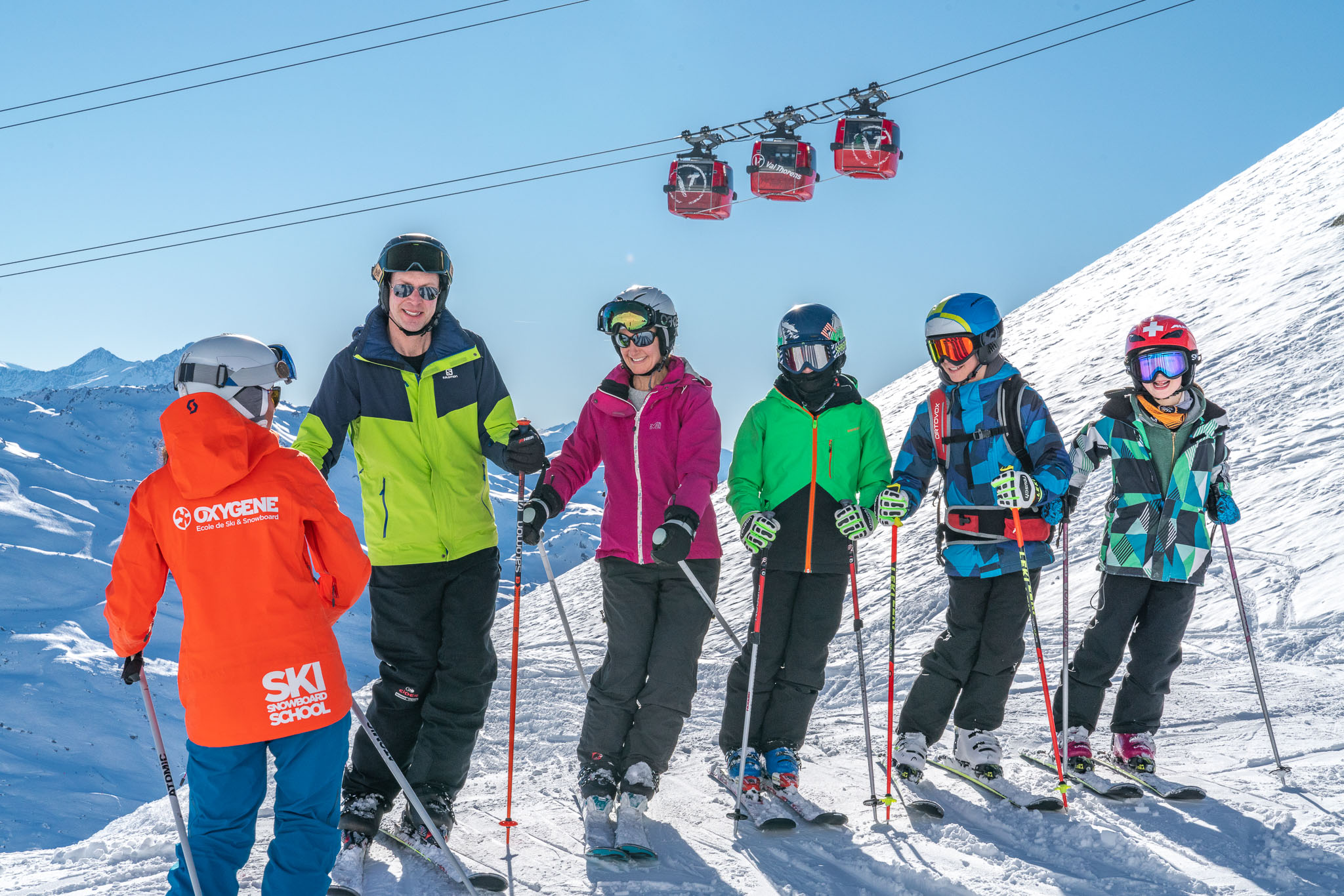 Oxygene female ski instructor in family ski lessons in Val Thorens