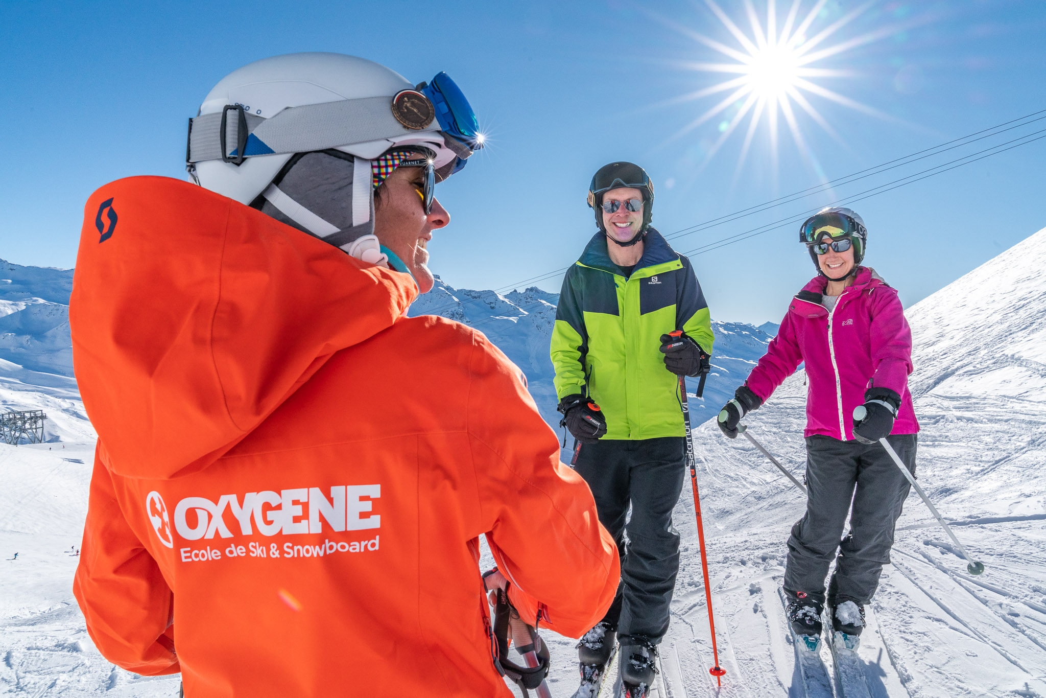 Oxygene ski instructors skiing with her students - 2019